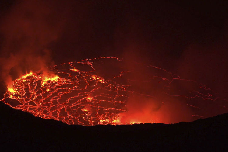 Mouth of the volcano with magma. Molten magma in the muzzle. activity, muzzle, magma, eruption, melted, stone, ash, vesuvius, kamchatka, eloston, catastrophe, apocalypse, fire, nature, volcano, active, background, landscape, lava, mountain, natural, outdoor, park, red, rock, scenic, smoke, view, volcanic, attraction, tourism, snowy, sicilian, tourist, panorama, orange, incandescent, central, starscape, dangerous, explosion, danger, mount, snow, scenery, hell, mouth, destination, stream, unesco Activity, Muzzle, Magma, Eruption, Melted, Stone, Ash, Vesuvius, Kamchatka, Eloston, Catastrophe, Apocalypse, Fire, Nature, Volcano, Active, Background, Landscape, Lava, Mountain, Natural, Outdoor, Park, Red, Rock, Scenic, Smoke, View, Volcanic, Attractio Ash Close-up Erupting Eruption Heat - Temperature Lava Molten Motion Nature Night No People Outdoors Power In Nature Sky Volcanic Crater Volcano