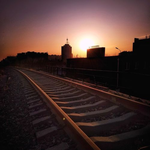 Sunset /Railway /shadows Skyline Cityscape Sunset Square Photography Shadows Nightfall Purple Color Urban Skyline City Politics And Government Sunset Sky Railroad Station Platform Railroad Track Office Building Train - Vehicle Railroad Platform Railroad Tie