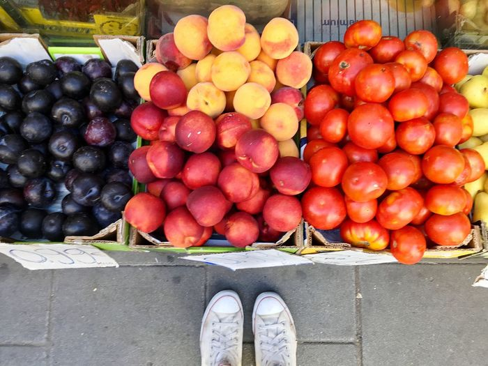 Feet Feetselfie Low Section Fruit Food Outdoors Market Freshness Day Red Large Group Of Objects Abundance Healthy Eating One Person Shoe Food And Drink Standing Choice Human Body Part