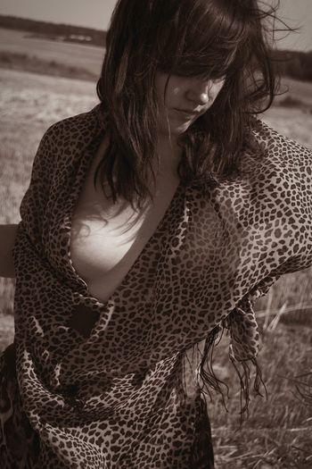 Seductive woman standing on field