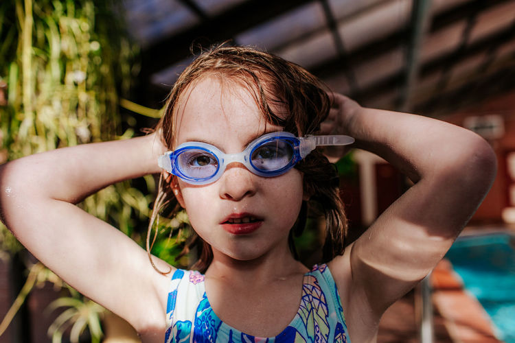 Portrait of a girl with swimming pool
