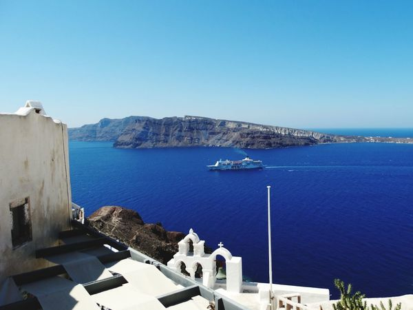 Sea Water Sunny Blue No People High Angle View Outdoors Architecture Nature Day Travel Destinations Beach Clear Sky Sailboat Scenics Building Exterior Harbor Nautical Vessel Sky Horizon Over Water Santorini, Greece Santorini View Vacations Cyclades Islands Mediteranean