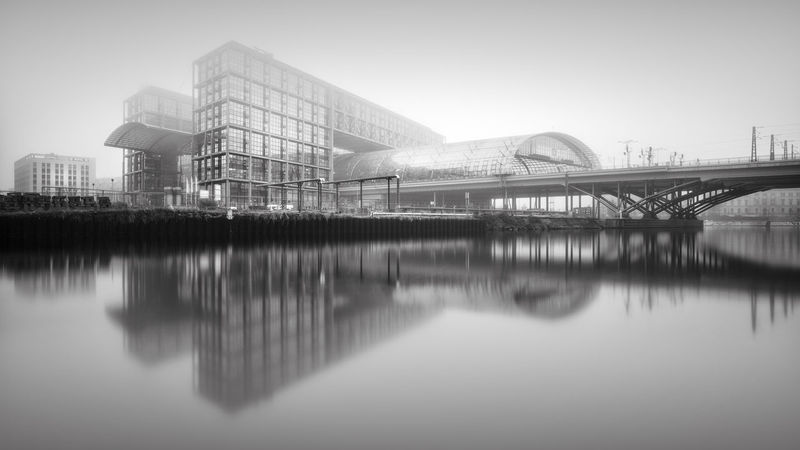 Berlin Central Station - misty reflection Architecture Berlin Berlin Central Station Black And White Bnw_captures Bnw_society Building Exterior Built Structure Business Finance And Industry City City Cityscape Fineart Hauptbahnhof Berlin Longexposure Modern Modern Architecture No People Outdoors Philipp Dase Reflection Sky Travel Travel Destinations Discover Berlin