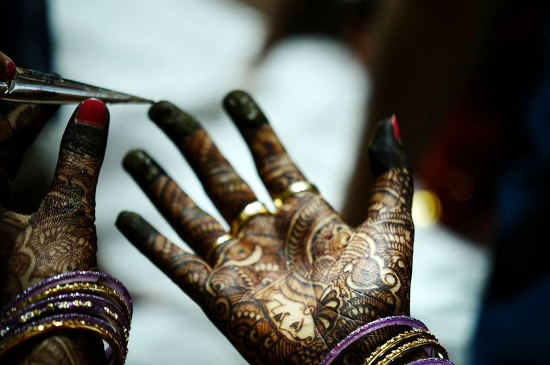 Beautiful bridal Mehndi Mehndi MehndiDesign Dark Brown Close-up Macro Photography Wedding Beautiful Ceremony Applying Human Hand Bangle Cultures Close-up Henna Tattoo Powder Paint Indian Culture  Hinduism Tattooing Wedding Body Adornment Bride Wedding Ring Ring