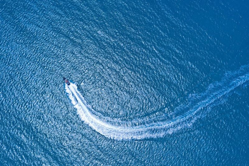 Ocean jet boat Speed Speedboat Boat Ocean Blue Water Full Frame Close-up Backgrounds Pattern Nature Splashing Purity Textured  Blue Background Motion Sport