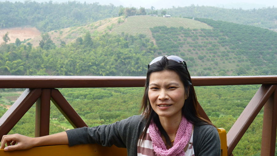 Portrait of smiling mature woman standing at observation point