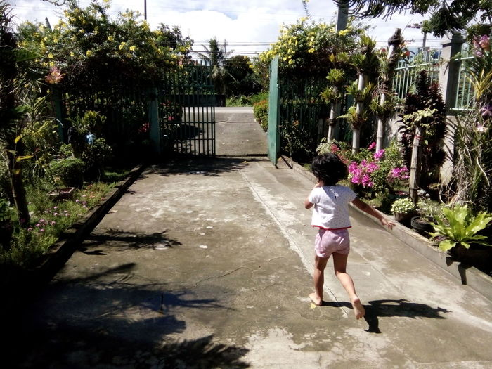 One Person Child Running Childhood Fun Under The Sun Outdoors Plants And Flowers Nature EyeEm The City Light Long Goodbye
