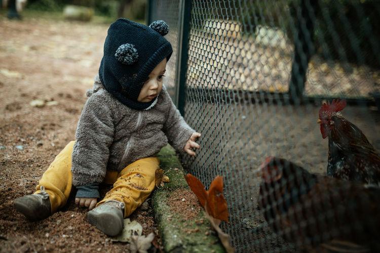 Rear view of boy wearing fence