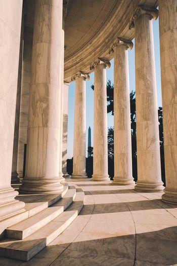 Columns by empty corridor