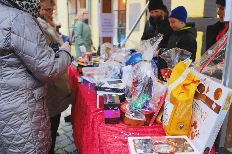 Lottery at outdoors Christmas market Chance Chanses Winner Win Lucky Number Prices Christmas Market Lottery Market Stall Market Business Finance And Industry Choice Men Retail  Women Consumerism Real People Adult Outdoors Day People City Adults Only Food One Person Young Adult
