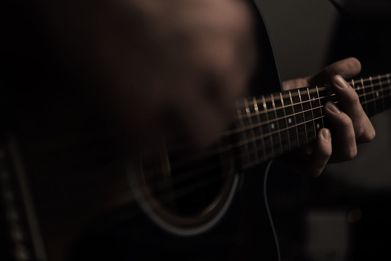 music, musical instrument, string instrument, guitar, musical equipment, arts culture and entertainment, one person, playing, string, musical instrument string, human hand, hand, human body part, real people, musician, artist, selective focus, indoors, plucking an instrument, holding, finger, body part, skill, acoustic guitar, rock music, electric guitar