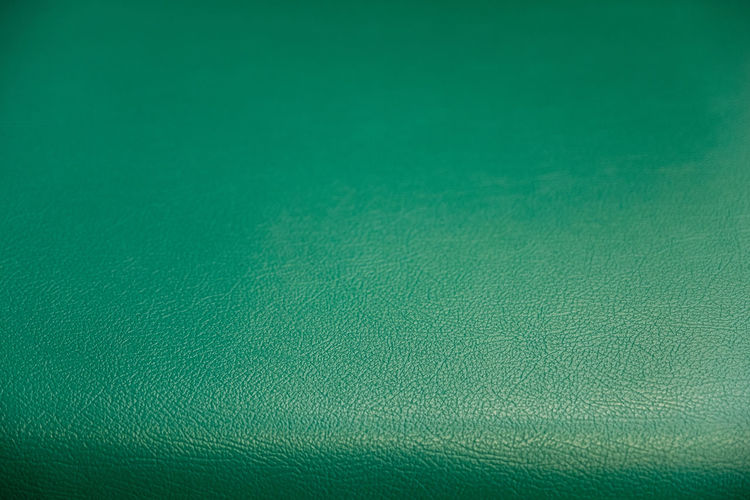 Surface pattern of green synthetic leather textured background, A textured background of soft and modern sofa backrest Full Frame Backgrounds Green Color Textured  No People Textile Close-up Pattern Indoors  Green Background Studio Shot Material Macro Extreme Close-up Copy Space Blue Abstract Colored Background Rough Single Object Leather Abstract Backgrounds Brightly Lit Textured Effect