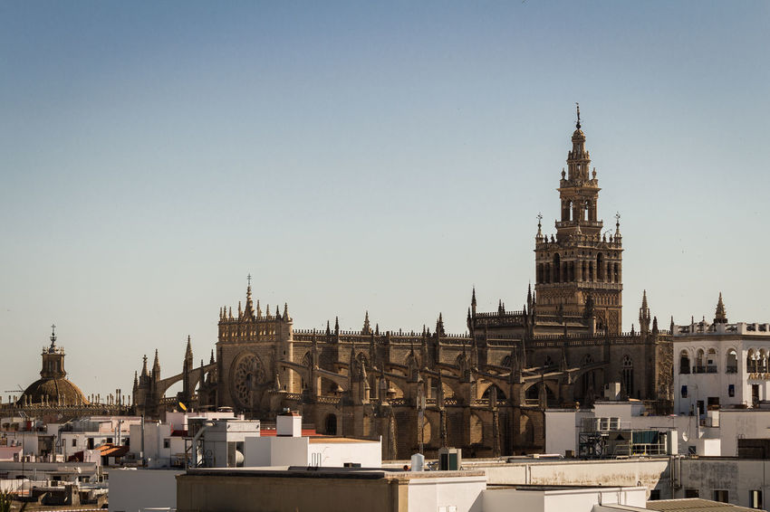 Giralda and cathedral of Sevilla, Spain Architecture Building Exterior Built Structure Catedral De Sevilla Cathedral City Cityscape Clear Sky Clock Tower Day Giralda History No People Outdoors Sky Travel Destinations
