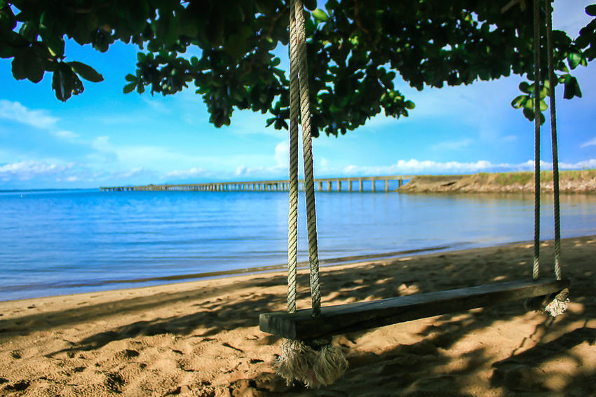 Swing on the beach. Beach Beauty In Nature Cloud - Sky Day Lake Land Landscape Sea Landscape Sea Nature Outdoors Landscape Seascape Nature No People Outdoors Plant Scenics - Nature Sky Sunlight Tranquil Scene Tranquility Tree Tree Trunk Trunk Water