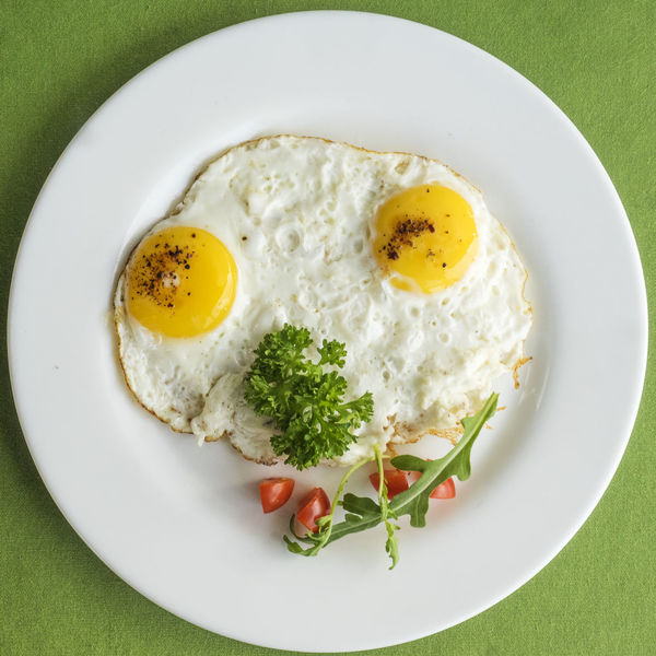 frying eggs with tomatoes and parsley Frying Breakfast Close-up Day Directly Above Egg Egg Yolk Eggs Food Food And Drink Freshness Fried Fried Egg Green Color Healthy Eating High Angle View Indoors  No People Parsley Plate Ready-to-eat Scrambled Still Life Sunny Side Up Table Tomatoes Yolk