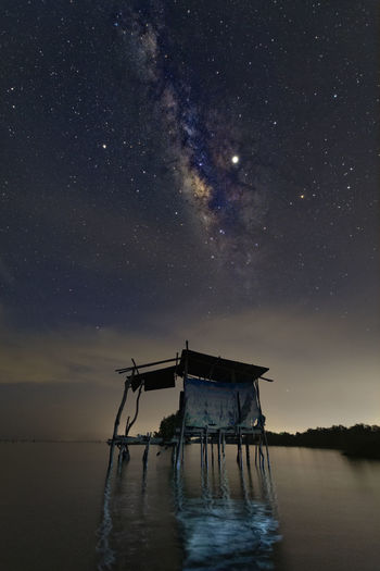 Scenic view of abandoned building against sky at night