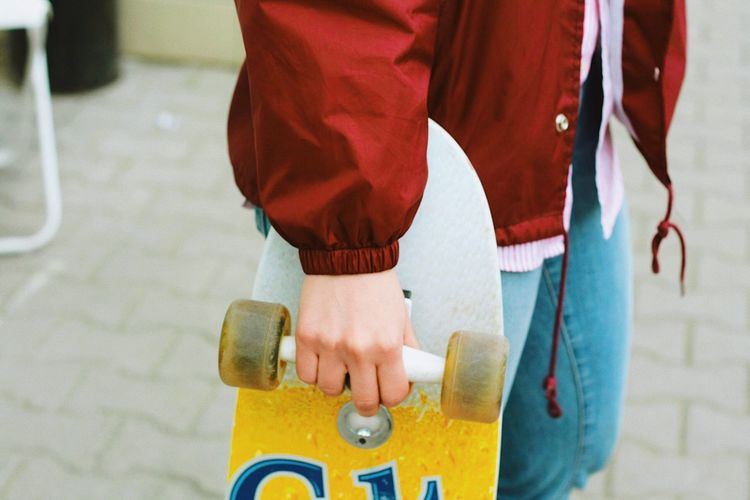 Skateboard Skateboard Park Skateboard Skateboarding Midsection City Street Real People People Human Body Part Day Women Hand Outdoors Focus On Foreground Yellow Body Part Red Lifestyles Adult Men Standing Road Human Limb Skate Photography: Same Tricks, New Perspectives