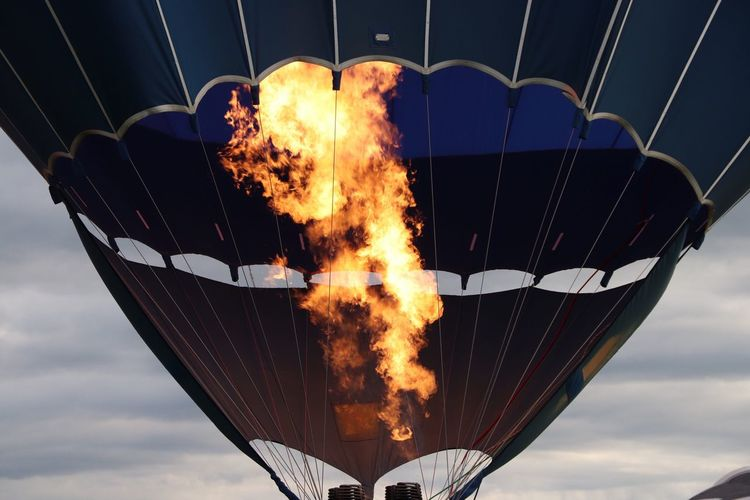 Dancing flames Hot Ballons EyEmNewHere EyeEm Best Shots Low Angle View Fire Flame Burning Fire - Natural Phenomenon Motion Sky Cloud - Sky Heat - Temperature No People Sport Outdoors Nature RISK