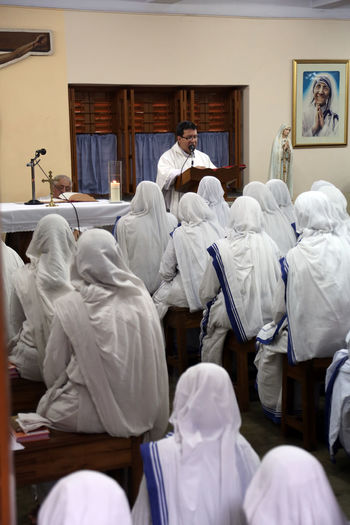 Sisters of The Missionaries of Charity of Mother Teresa at Mass in the chapel of the Mother House, Kolkata, India at February 07, 2014. Missionaries Agnes ASIA Bojaxhiu Calcutta Catholic Charity Christianity Faith Gonxhe Humanitarian India Kolkata Mass Mission Mother Mother House Nun Poor  Priest Prize Religious  Sister Teresa West Bengal