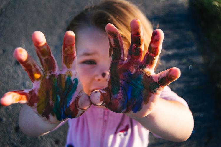 Portrait of girl showing watercolor paints