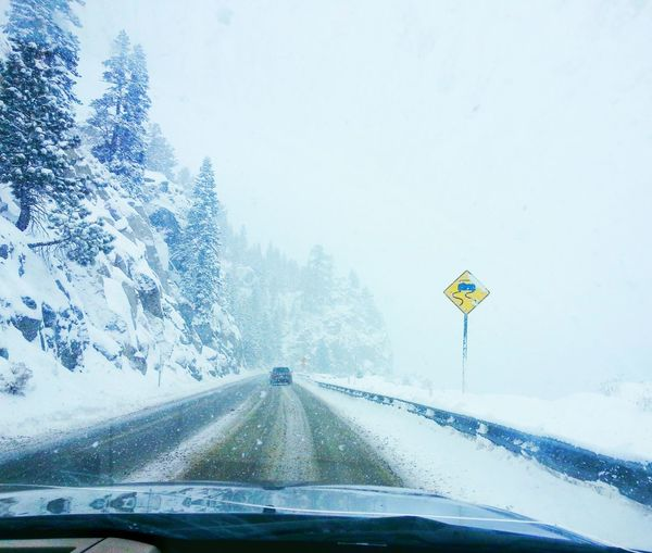 Driving Car Windshield Sky Traffic Snow Journey Road Car Interior Cloud - Sky Nature Outdoors No People Mode Of Transport Transportation Tree Day Tahoe South Lake Tahoe Winter Cold Temperature Storm Snow Storm Windy Road Sign