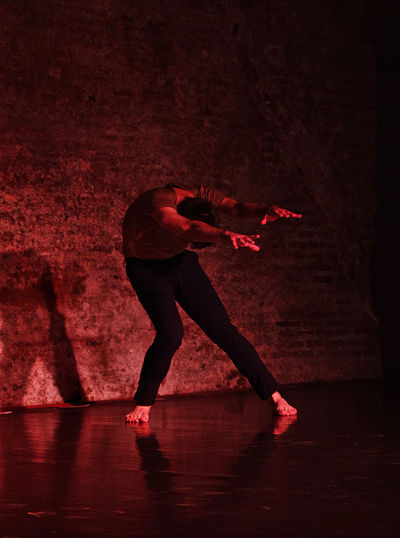 Man dancing in darkroom