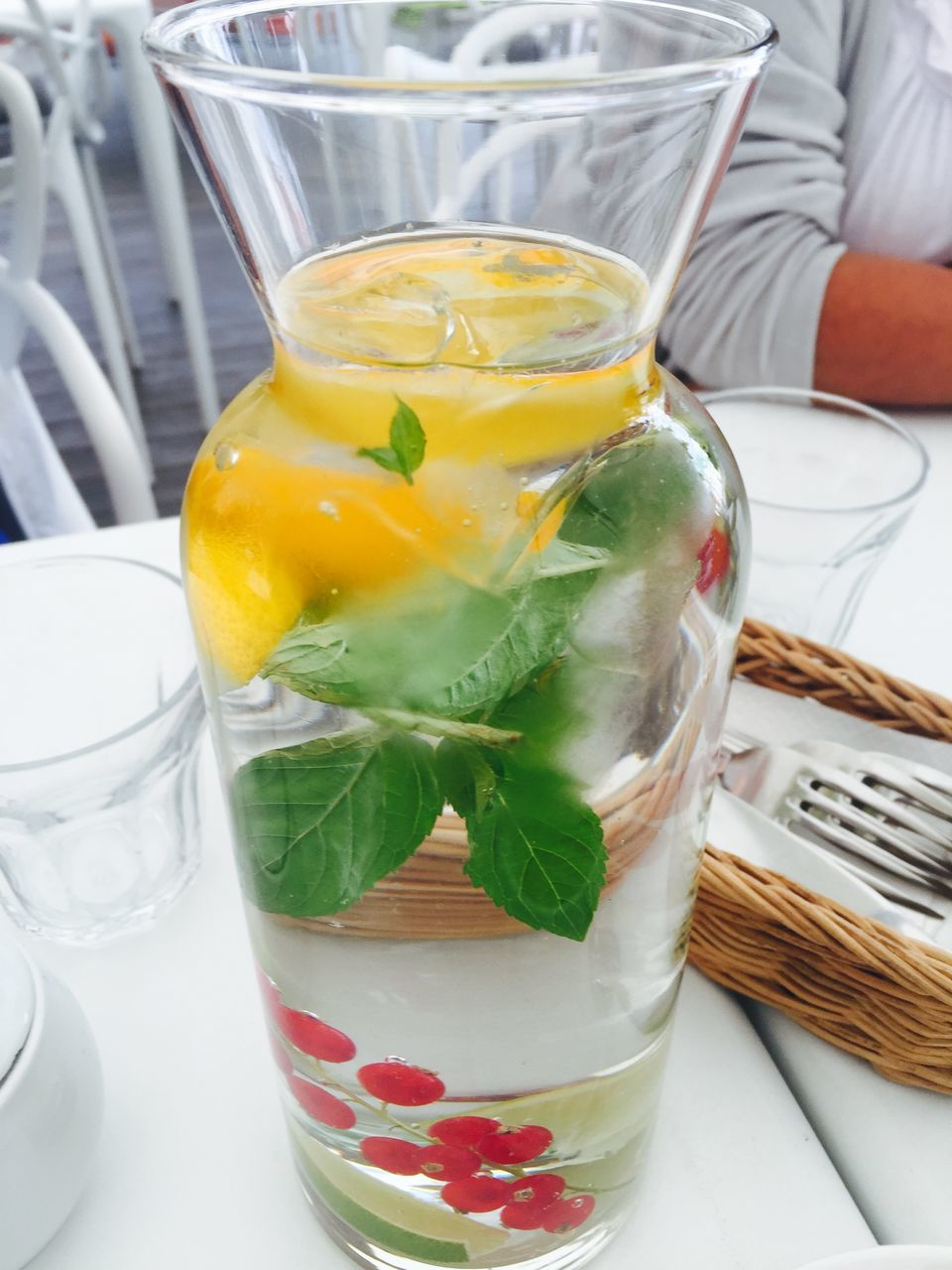 Close-Up Of Fresh Drink In Glass Container On Table