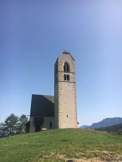 Architecture Built Structure Tower Religion Low Angle View Building Exterior No People Day Clear Sky Place Of Worship Spirituality Blue Bell Tower Outdoors Grass Sky Nature