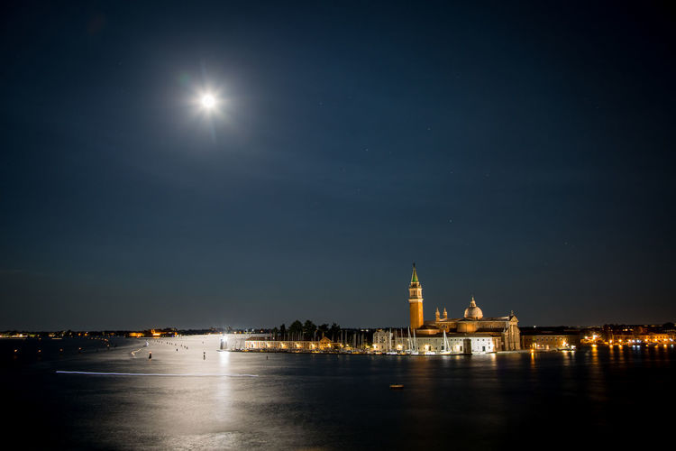 Church of san giorgio maggiore by grand canal against sky at night