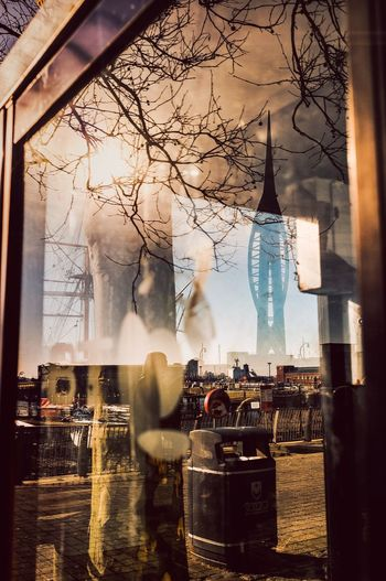 Reflection of people on glass window in restaurant