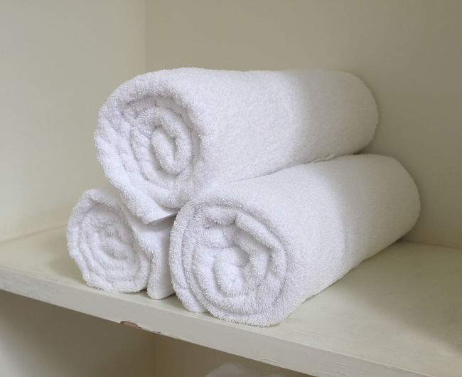 Close-up of towels on shelf