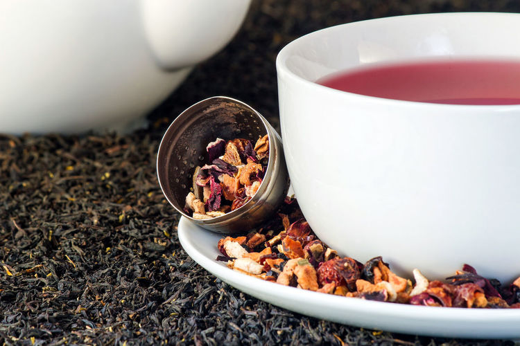 Fruit tea in a white cup with loose tea around and green tea and white tea pot as background. Tea Fruit Tea Fruit Green Tea ❤️ Tea Cup Cup Cup Of Tea Tea Time Tea Pot Loose Tea Tea Leaves Tea Light Hot Drink Drink Close-up Sweet Food Food And Drink Dried Fruit Tea - Hot Drink Beverage Green Tea Chinese Tea Tea Ceremony Herbal Tea Teabag Teapot