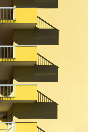 The Architect - 2018 EyeEm Awards The Creative - 2018 EyeEm Awards The Still Life Photographer - 2018 EyeEm Awards Accidents And Disasters Apartment Architecture Building Building Exterior Built Structure Day Nature No People Outdoors Pattern Railing Repetition Safety Shadow Shadow Photography Staircase Steps And Staircases Sunlight Wall - Building Feature Yellow #urbanana: The Urban Playground