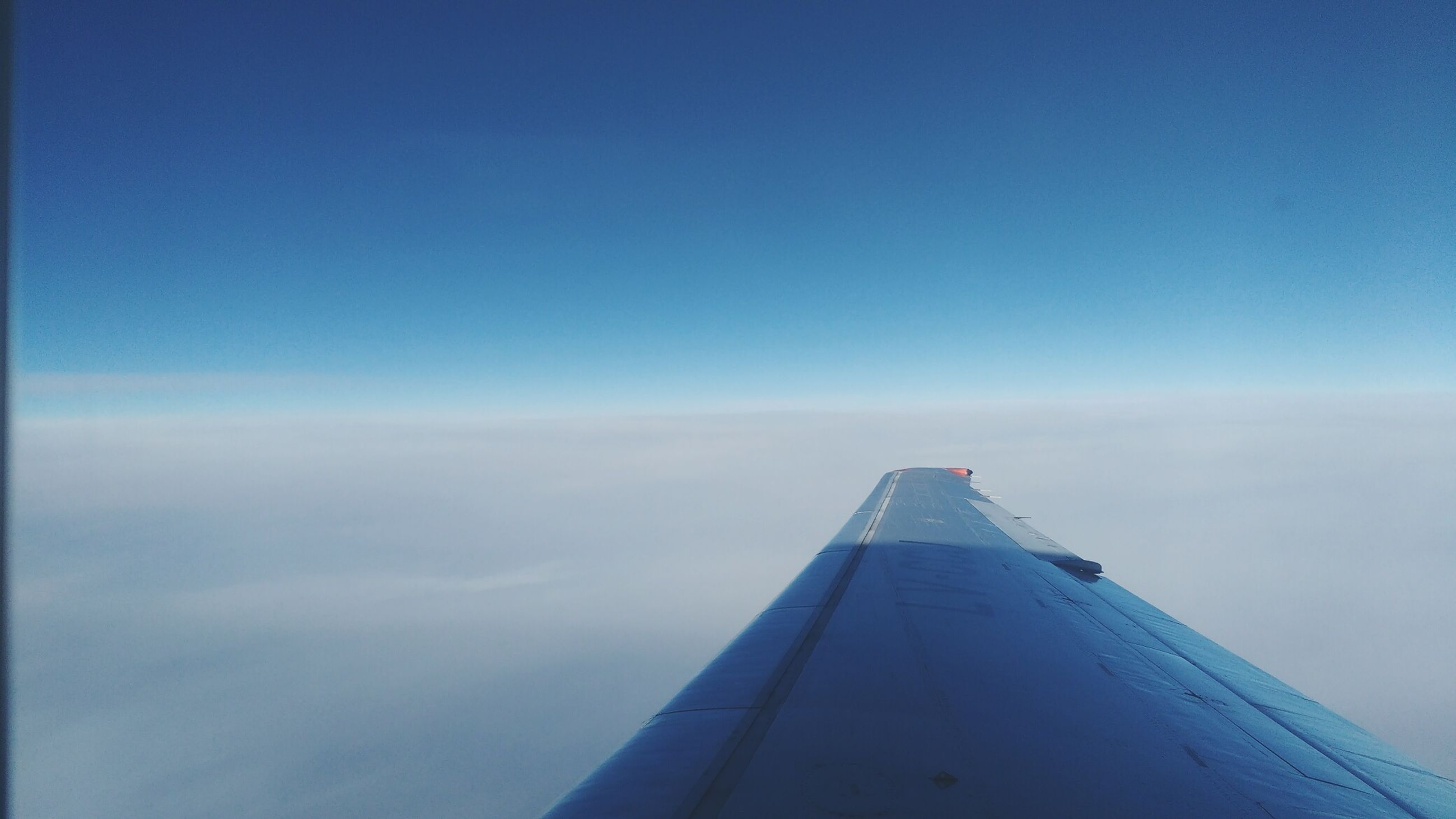 blue, copy space, no people, sky, airplane, outdoors, day, transportation, nature, flying, close-up, airplane wing