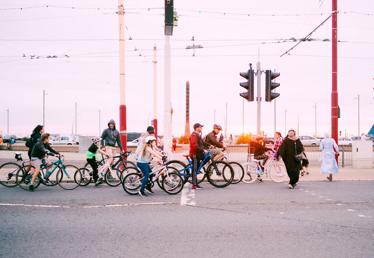 Bicycles on road against sky