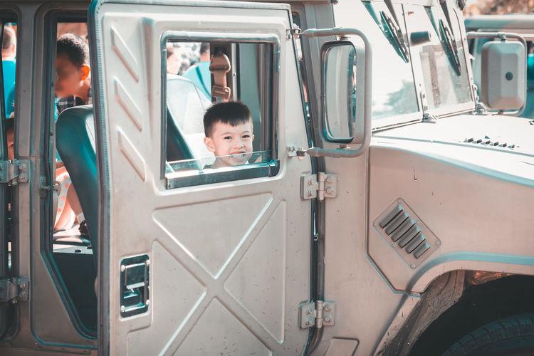 Portrait of boy in vehicle