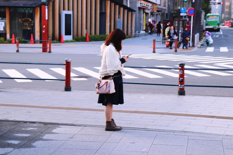 🎆⛩ Japan City Architecture Street One Person Women Building Exterior Road Incidental People Walking Adult City Life Real People Day Crossing Rear View Built Structure Footpath Full Length Crosswalk Lifestyles