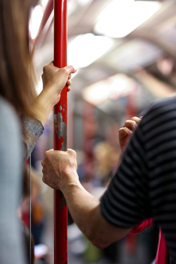 Close-Up Of Hands Holding Red Pole