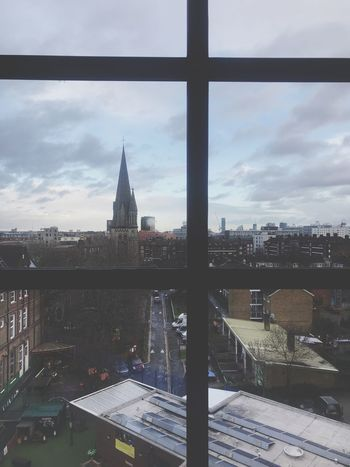Looking through a window Architecture Built Structure Building Exterior Sky City Cloud - Sky Building Cityscape Window No People Spire  Outdoors Day