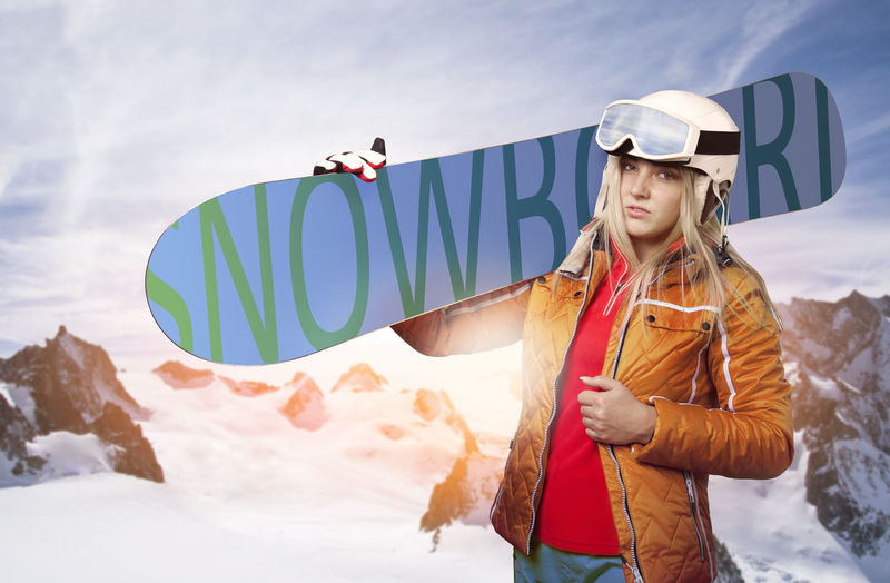 Adrenaline Blonde Goggles Sunlight Wintersport Woman Action Free Ride Free Ski Freeride Fun Sports Leisure Activity Lens Flare Sun Mountains One Person Outdoors Portrait Real People Skier Snow Snowboard Snowboarder Young Adult