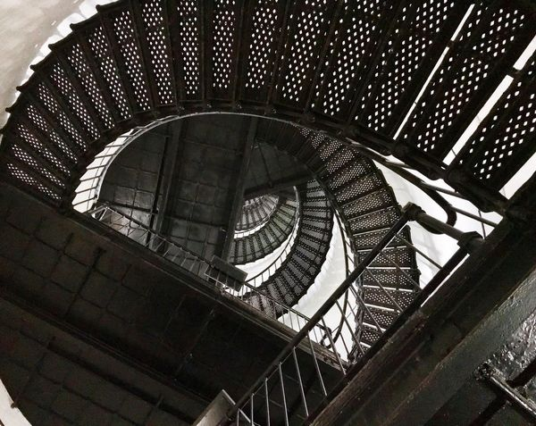 Spiral staircase of the hunting island lighthouse Built Structure Architecture Staircase Low Angle View Indoors  Steps And Staircases Railing No People Day Modern