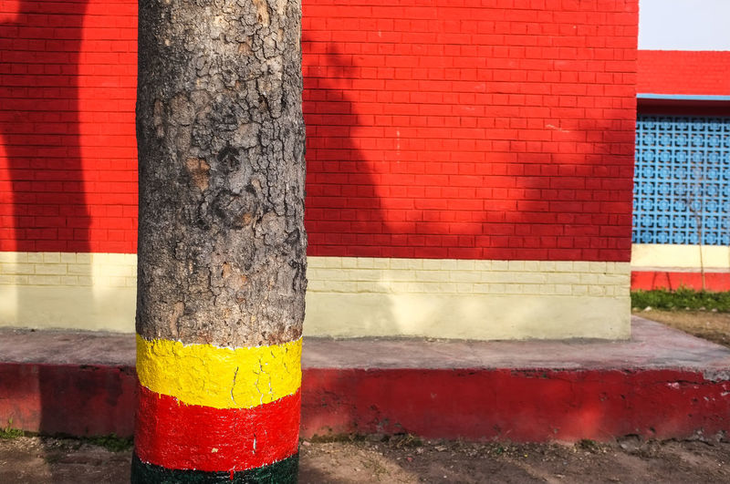 Travel Red Built Structure Wall - Building Feature No People Day Architecture Striped Sign Yellow Communication Building Exterior Outdoors Tree Trunk Wall Nature Pole Multi Colored Road Trunk Warning Sign Brick Architectural Column School Pakistan The Architect - 2019 EyeEm Awards