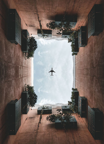 Airplane flying over buildings in city