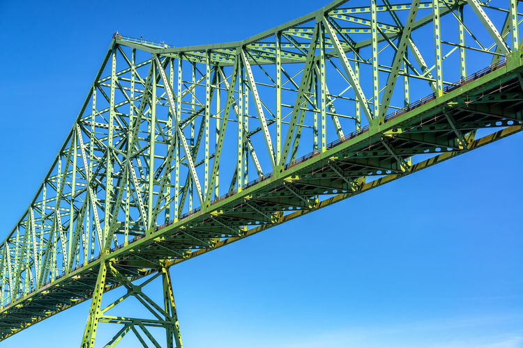 View of a portion of the Astoria Megler Bridge with a beautiful blue sky in Astoria, Oregon Astoria Oregon Pacific Northwest  Columbia River River Travel Travel Destinations Tourism Astoria-megler Bridge Bridge Transportation Sky Architecture Built Structure Blue Day Outdoors Green Color Low Angle View Connection Metal Clear Sky Bridge - Man Made Structure No People Steel Girder