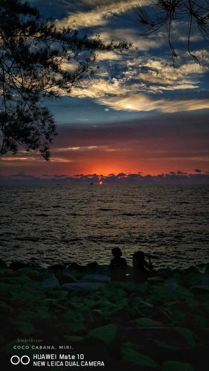 Sunset at Coco Cabana Miri, Malaysia Coco Cabana Water Sea Sunset Tree Beach City Silhouette Reflection Summer Sun First Eyeem Photo