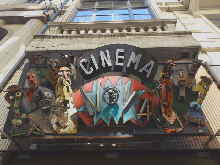 CINEMA. Arch Architectural Feature Architecture Art Building Built Structure Day Lifestyles Low Angle View Ornate Building Exterior Masks Window City Close-up The Architect - 2016 EyeEm Awards Window Reflections