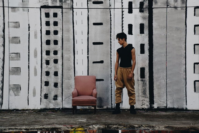 Der Sessel Model Menswear Mensfashion Menstyle Male Male Dancer Male Model EyeEmNewHere Graffiti Urban Portrait Streetphotography Streetart Street Art Street Chair Armchair Full Length Men Standing Casual Clothing Trousers Hands In Pockets Hood Spray Paint Posing Street Scene Hip Hop A New Beginning This Is Strength