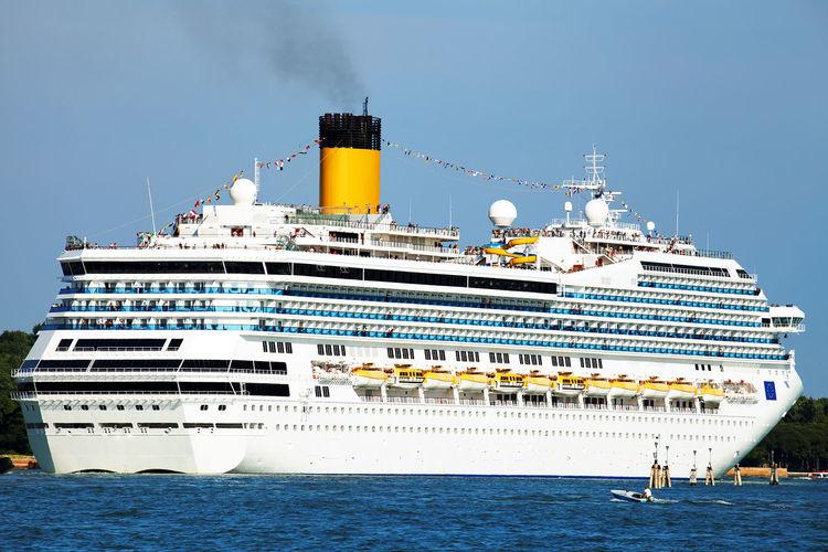Cruise ship on sea against clear blue sky