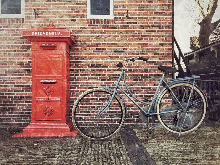 Bicycle parked near the red post box, red brick as background Vintage Photo GrungeStyle Bicycle Red Post Box Brick Wall Red Building Exterior Architecture Built Structure Day No People First Eyeem Photo