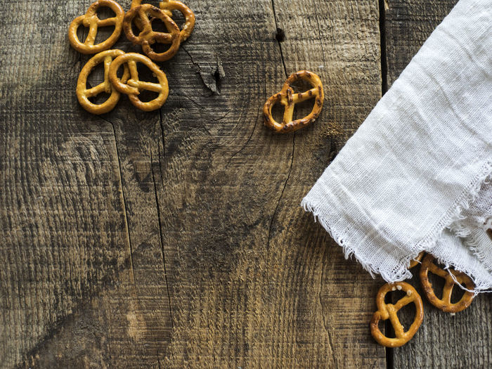High angle view of wheat pretzels on linen fabric